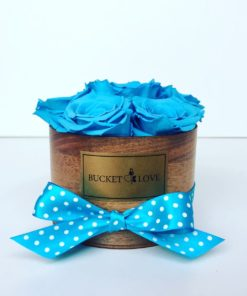 Blue roses in a box